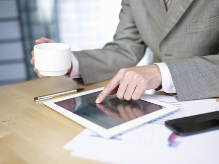 businessman working in office with tablet computer