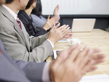 appreciating: business people applauding during meeting