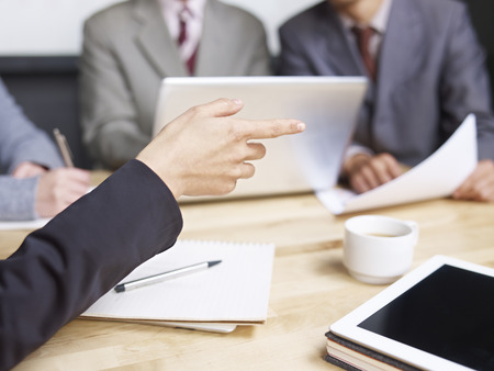 persuading: business people meeting in office
