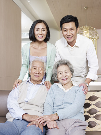 mother in law: home portrait of a happy asian family
