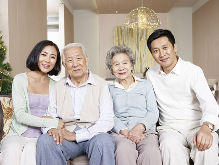 home portrait of a happy asian family Stock Photo - 26984303