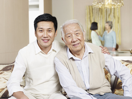home portrait of asian father and son photo