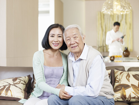 daughter in law: home portrait of asian father and daughter Stock Photo
