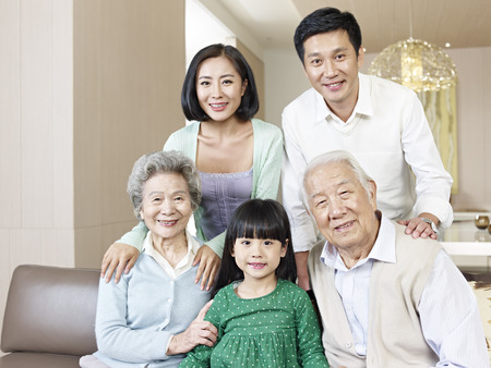grandmother grandchild: home portrait of a three-generation asian family