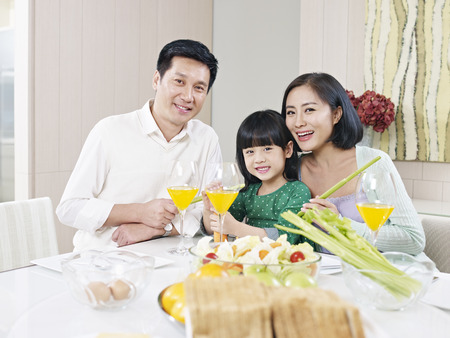 asian family having meal at home photo
