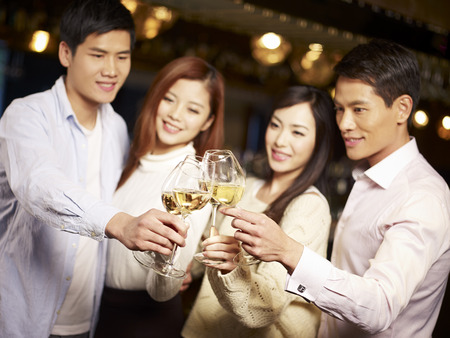 young asian friends couples enjoying party in pub  photo