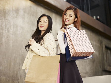 korean fashion: young asian women with shopping bags  Stock Photo