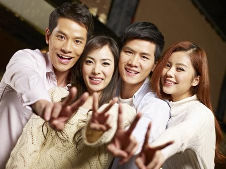 singaporean: young asian couples having fun in bar