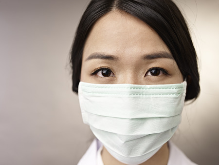 doctor mask: face of a woman wearing a mask