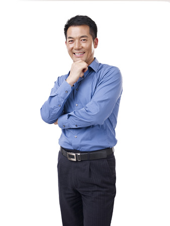 blue collar: studio portrait of an asian businessman, hand on chin