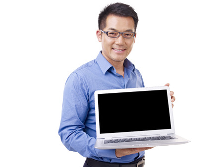 selling service smile: asian businessman holding laptop computer, isolated on white