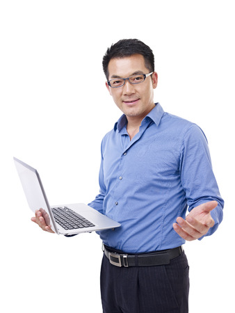 asian teacher: businessman holding laptop computer, isolated on white  Stock Photo