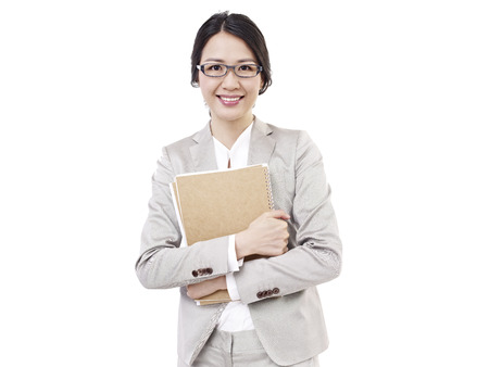 business attire teacher: young woman with notebook in hand, isolated on white