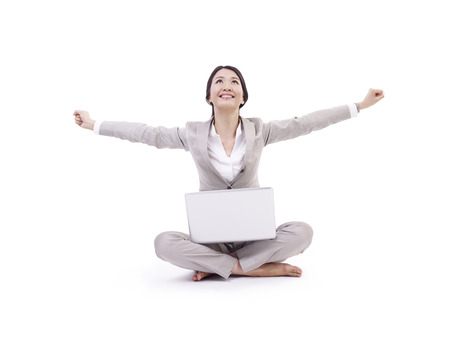 outstretching: asian businesswoman sitting on floor using laptop computer, isolated on white