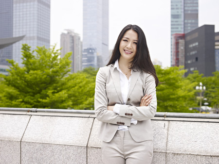 portrait of a young asian businesswoman smiling  photo