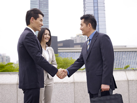cooperative: business people shaking hands