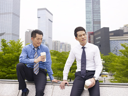 asian business executives having a bad day  photo