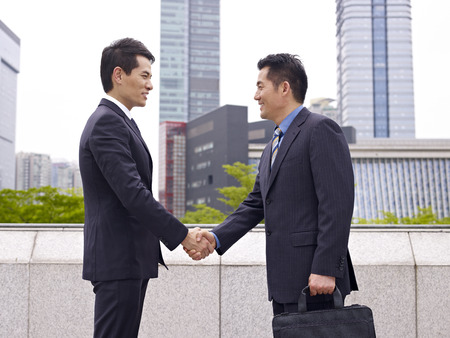 cooperative: business people shaking hands. Stock Photo