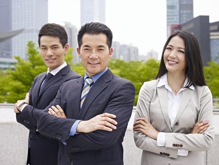 outdoor portrait of an asian business team.
