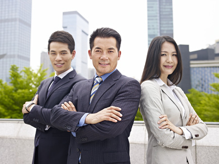 outdoor portrait of an asian business team.