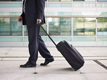 business traveller: businessperson traveling with luggage.