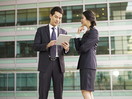japanese woman: asian man and woman discussing business. Stock Photo