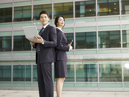 asian success: portrait of a businessman and a businesswoman.