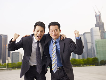 asian businessmen celebrating.