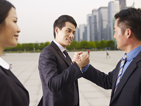asian businessmen greeting each other. photo
