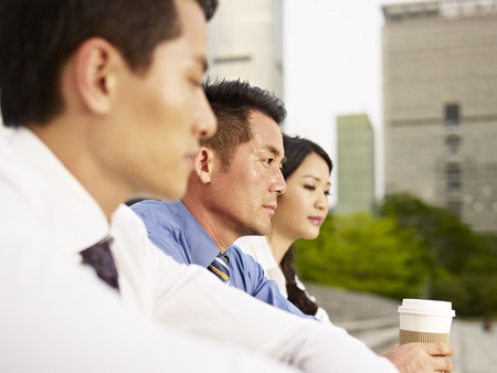 asian business people looking depressed. photo
