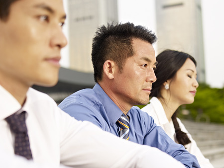 dof: asian business people looking depressed. Stock Photo
