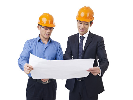 asian businessmen with safety helmet and blueprint.