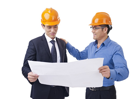 asian businessmen with safety helmet and blueprint. photo