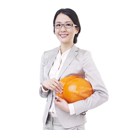 asian businesswoman with safety helmet. photo