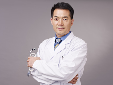 studio portrait of an asian doctor.