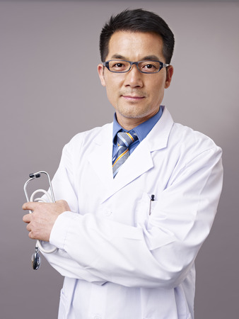 chinese medical: studio portrait of an asian doctor.
