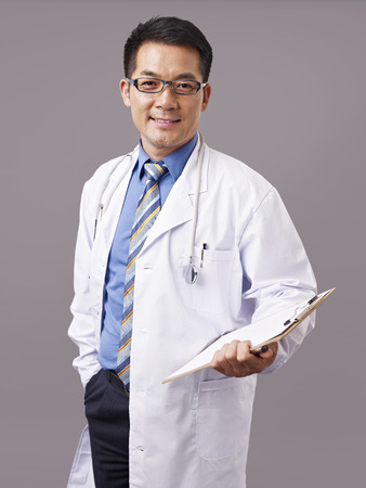 studio portrait of an asian doctor.