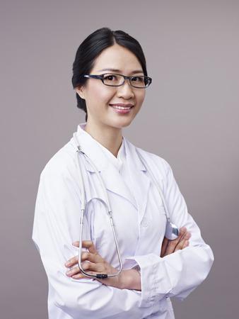 studio portrait of an asian doctor. photo