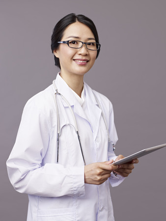 medical professional: studio portrait of an asian doctor.