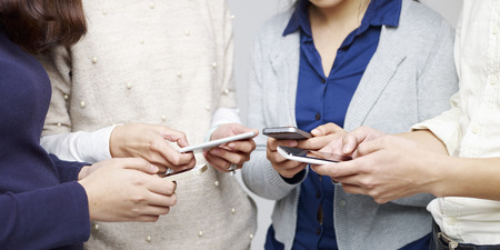 small group of people using cellphones together. photo
