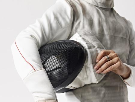 fencing foil: fencer with fencing mask.