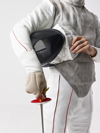fencing: fencer with fencing mask and rapier.