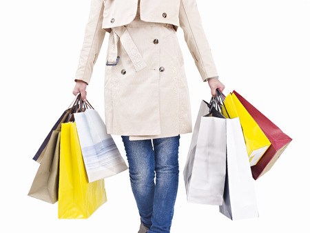 woman bag: woman walking with colorful shopping bags, isolated on white. Stock Photo