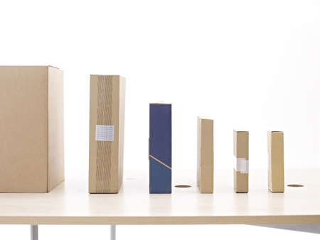 warehouseman: carton boxes lined up on table.