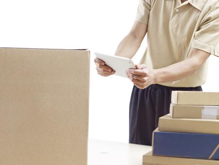 warehouseman: warehouse man working using tablet computer.