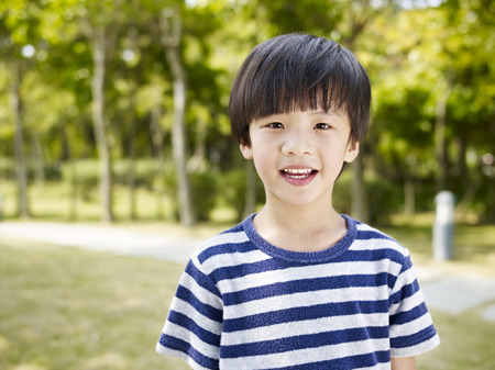outdoor portrait of a little asian boy. Stock Photo