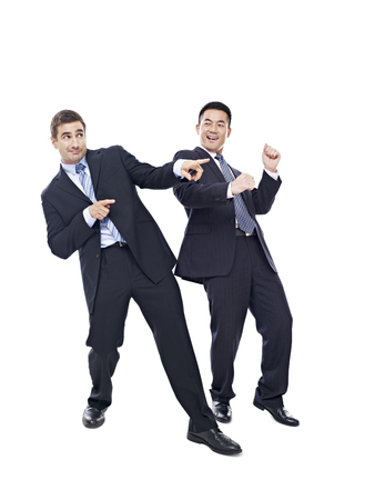 office wear: two happy businessmen dancing, isolated on white background.