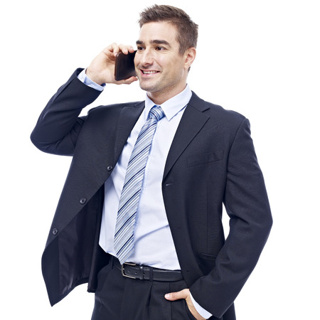 westerner: caucasian business person talking on cellphone, happy and smiling, isolated on white background. Stock Photo
