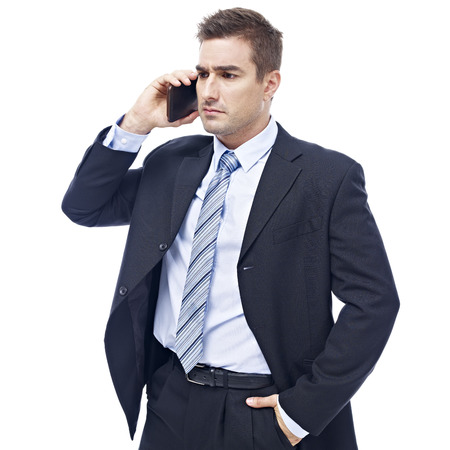western attire: caucasian business person talking on cellphone looking serious and unhappy, isolated on white background.