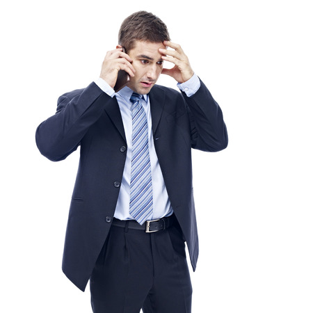 call: caucasian business person talking on cellphone, disappointed and frustrated, isolated on white background. Stock Photo
